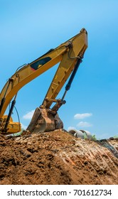 An excavator or  tractor is an engineering vehicle specifically designed to deliver a high tractive effort (or torque) at slow speeds, for the purposes of hauling.