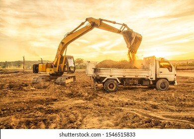 Excavator and truck on new construction site at Chiang Rai,Thailand