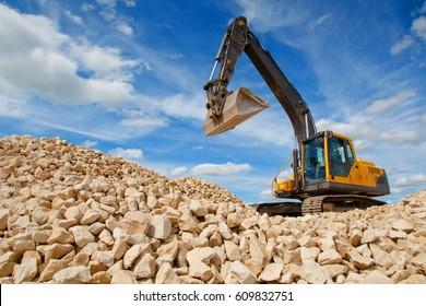 Excavator unload gravel.