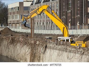Excavator at an urban demolition site