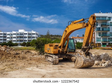 Excavator waiting for a work in a quarry