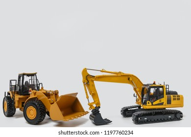 Excavator and Wheel loader model isolated on white background in industrial construction