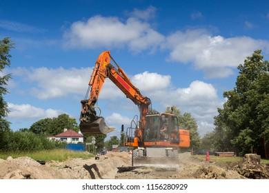 excavator work on construction site, street reconstruction