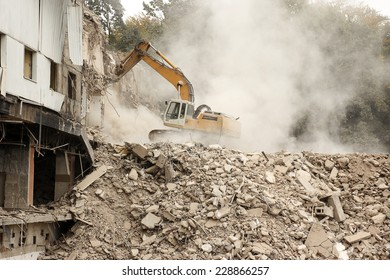 Excavator working in a demolition