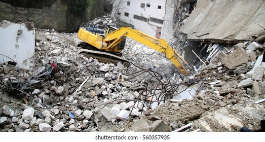 an excavator working at demolition site
