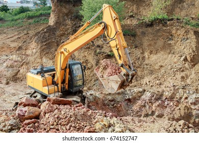 Excavator working on a construction site. The digging of the trench.