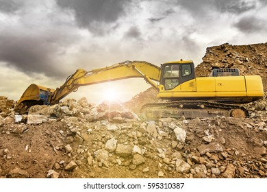 Excavator working on the excavation works of a road, moving rock and earth
