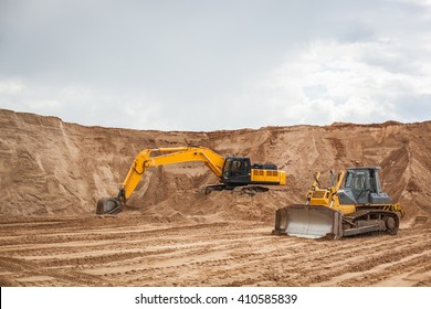 An excavator working removing earth on a construction site.
