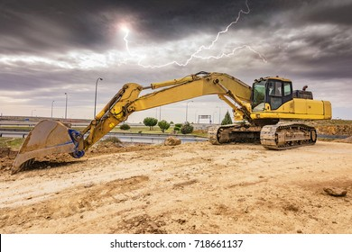 Excavator working ... but the storm starts
