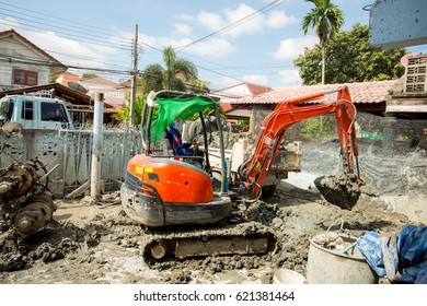 Excavators digging at construction site, renovate concept