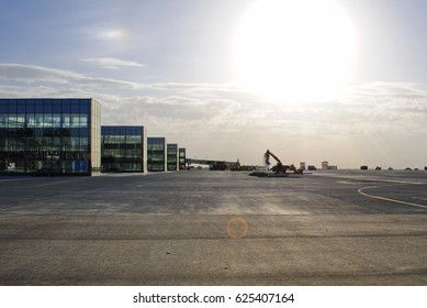 Excavators and dump trucks on the platform of the international airport under construction in Donetsk