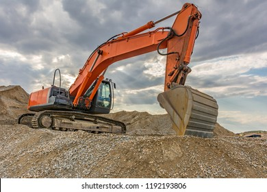 Excavators and heavy machinery in the works of stone movement in a quarry stone extraction for its transformation into gravel