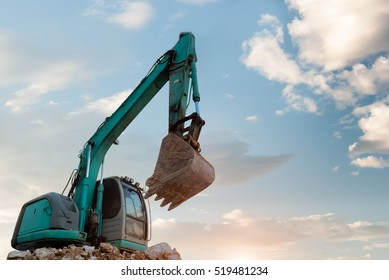Excavators machine in construction site on blue sky background