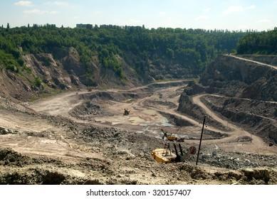 Excavators at open Quarry site