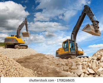 Excavators work with a stone. Concept - stone quarry. Production of natural stone. Two excavators during work. Concept - sale of tracked excavators. Rental construction equipment. Tracked machinery.