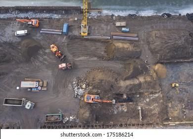 Excavators working at construction site, top view
