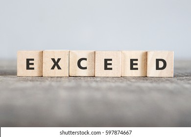 EXCEED word made with building blocks