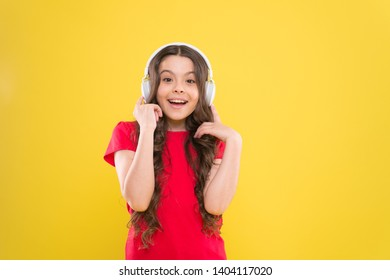 Excellent audio sound quality. Child teen enjoy music playing in earphones. Little girl enjoying favorite music. Catch the rhythm. Kid listening music headphones. Entertainment and fun. Top songs.