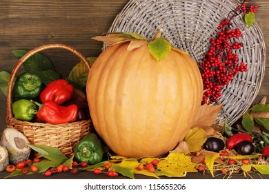 Excellent autumn still life with pumpkin on wooden table on wooden background