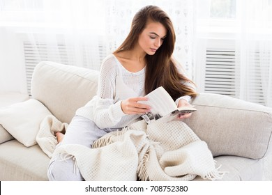 Excellent book. Beautiful young woman reading a book at the sunny morning.