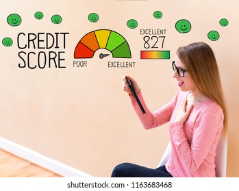 Excellent Credit Score with young woman using her tablet computer