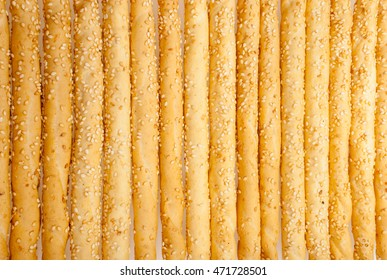 Excellent and natural breadsticks with sesame seeds with them clearly visible on the surface, isolated on white background
