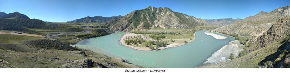 excellent panorama of the mountainous Altai overlooking the confluence of the turquoise Katun river and the gray river Chuya