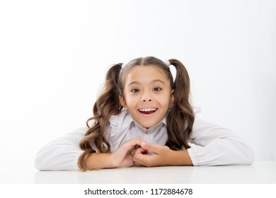 Excellent pupil lean on desk isolated white. Perfect schoolgirl with tidy fancy hair. School hairstyle ultimate top list. Prepare kid first school day. Schoolgirl happy smile cute ponytail hairstyle.