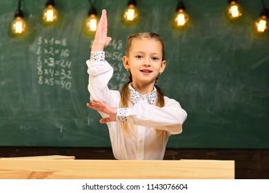 excellent pupil. excellent pupil with raised hand. excellent pupil knows answer. school lesson with excellent pupil