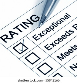 """""""Excellent"""" rating, with ballpoint pen.  Blue toned image."""