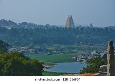 """Excellent view of Virupaksha temple tower on the banks of Tungabhadra river, Hampi, Karnataka, South India"""