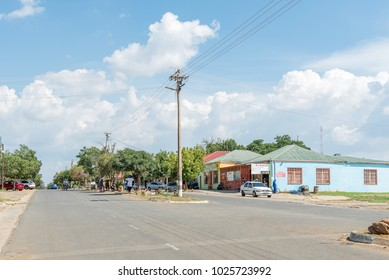 EXCELSIOR, SOUTH AFRICA, FEBRUARY 9, 2018: A street scene, with supermarket and people, in Excelsior, a small town in the Free Strate Province