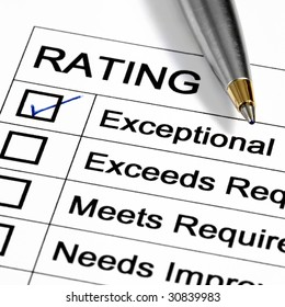 """""""Exceptional"""" rating marked with pen.  Could be performance appraisal, customer service rating, business performance evaluation."""