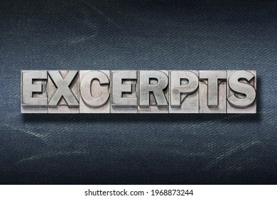 excerpts word made from metallic letterpress on dark jeans background