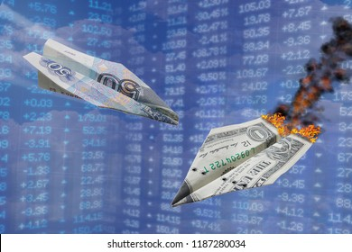 Exchange rate illustration. Strong ruble rate hits dollar like one war paper plane hits another. Ruble vs dollar. Russian rouble grows up. Paper planes air fight. World money currency devaluation