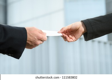 Exchanging business card. Corporate concept.