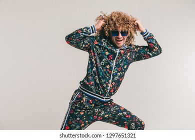 51b1c7b901 Excited adult funny man in stylish vintage clothes posing on white studio  background. 80s fashion