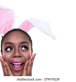 Excited African American black woman wearing Easter bunny ears with copy space. Ethnic girl dressed in Spring rabbit costume