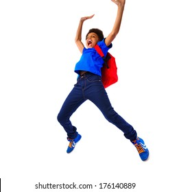 Excited African American school boy jumping happy, hands up, hanging on a board. Studio shot, isolated, over white background, with copy space.