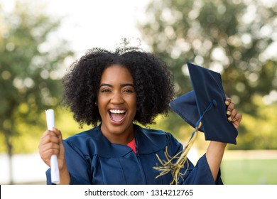 Excited African American woman at her graduation.