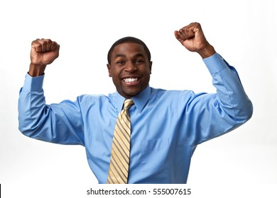 Excited African business man with his arms in the air isolated on a white background.