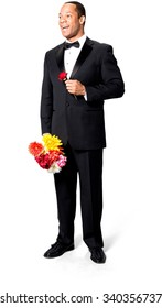Excited African man with short black hair in evening outfit holding flower - Isolated