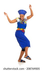 excited african woman in traditional clothes dancing