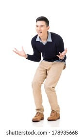 Excited Asian young man, full length portrait.
