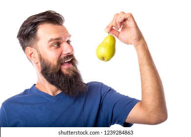 Excited bearded young man holding a ripe pear over white background