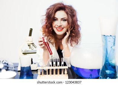 Excited Beautiful Sexy woman Scientist with a test beaker of Love Potion fresh for Valentine's Day