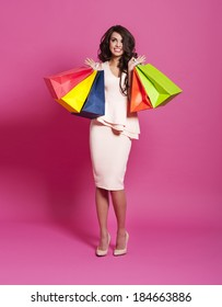 Excited beautiful shopaholic with shopping bags