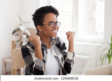 Excited black girl feeling winner celebrating great offer result opportunity, happy african woman motivated receive good news on laptop, intern worker hired promoted, get new job, college admission
