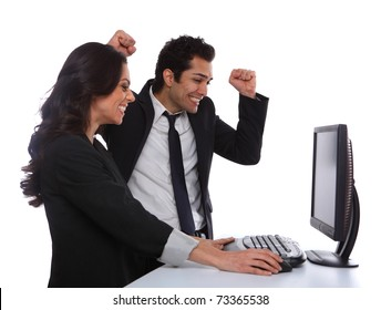 Excited Business couple looking at the desktop computer