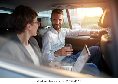 Excited business coworker in back seat of car